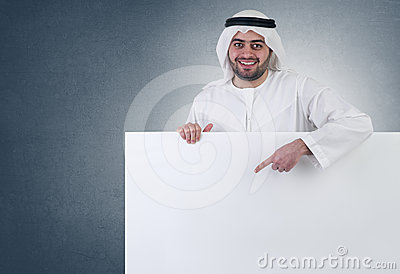 Arabian business man pointing at a blank  sign