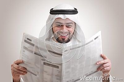 Arabian business man reading newspaper