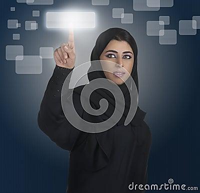 Arabian business woman pressing a touchscreen