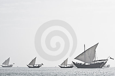 Arabian Dhow sailing out of the mist Editorial Image