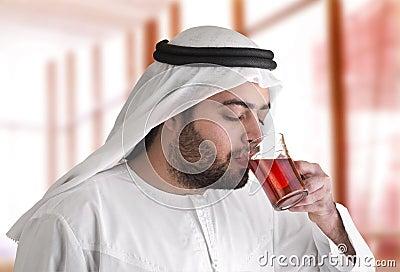 Arabian guy drinking tea / aroma tempting beverage