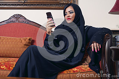 Arabian lady wearing hijab chatting