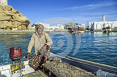 Arabic ferry man transports passenger in an old traditional boat Editorial Stock Photo