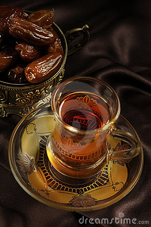 Arabic tea cup and dates