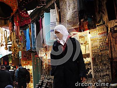 Arabic woman shopping at the bazaar Editorial Stock Image