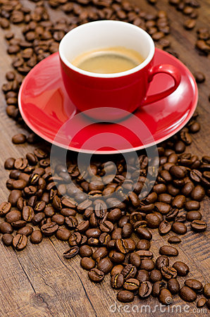 arabica coffee beans and red mut on a black brown wooden. Black Bedroom Furniture Sets. Home Design Ideas