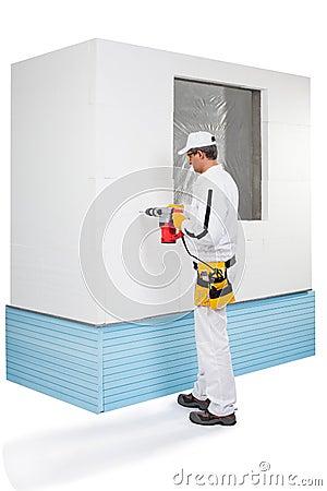 Arbeider het boren met een perforator