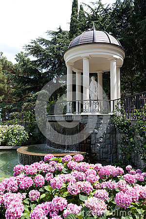Free Arbour With Waterfall In Garden Stock Photo - 25552300