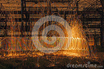 Arc of light from burning steelwool