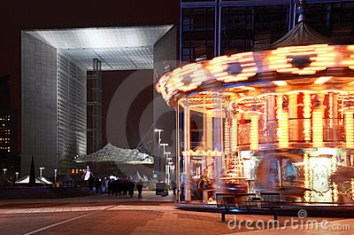 Arch of La Defense and whirling carousel in Paris Editorial Photo