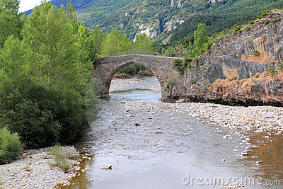 Arch stone bridge in romanesque Hecho village