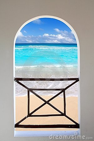 Arch window tropical Caribbean beach seen through