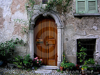 Arched entrance door Tuscany italy