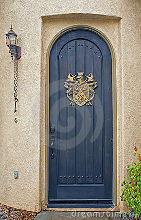 Arched front door on California home