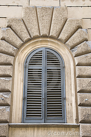 Arched window closed shutters, Italy.