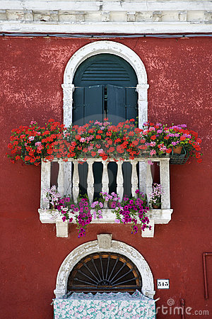 Free Arched Window With Balcony And Flowers Royalty Free Stock Photography - 12979927