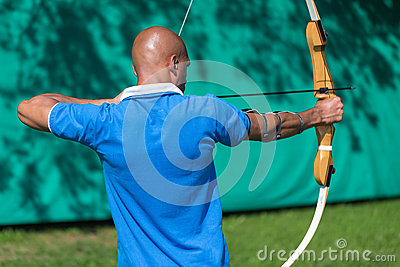 Archer at shooting range with bow and arrows
