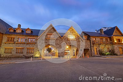 Arches connecting main square and Mitre street near Civic Center in downtown Bariloche at sunset - Bariloche, Patagonia, Argentina Stock Photo