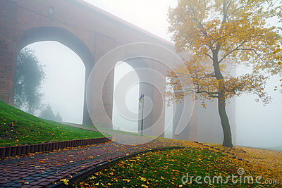 Arches of Kwidzyn castle in fog