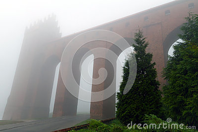 Arches of Kwidzyn castle in foggy day