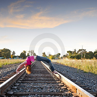 Free Arching Back Over Railroad Tracks Stock Photo - 22629840