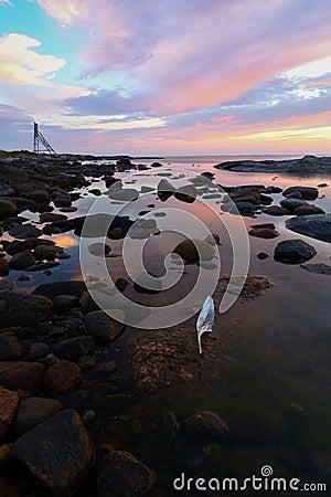 Sunrise over rocky coastline