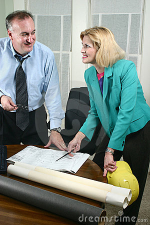 Architect And Client Looking At Blueprints 7