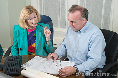 Architect And Client Looking At Blueprints 8