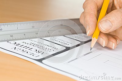 Architect Drawing Plans by Ruler