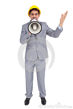 Architect with hard hat shouting with a megaphone