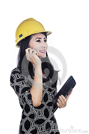 Architect holding cellphone and tablet