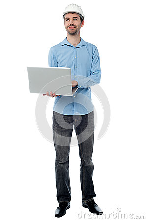 Architect holding laptop and looking upwards