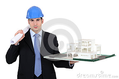 Architect holding model housing