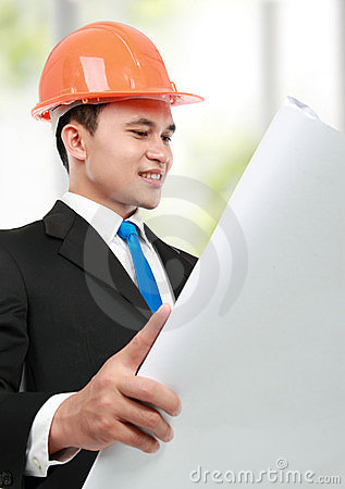 Architect looking at paper print in the office