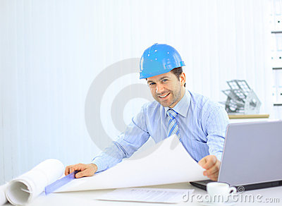 Architect looking working in office at desk.
