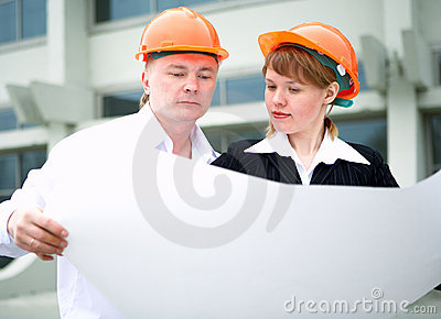 Architect man and woman in helmet