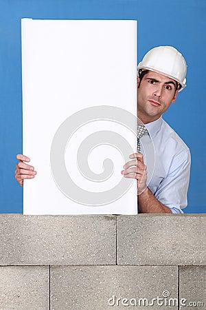 Architect presenting his blueprint.
