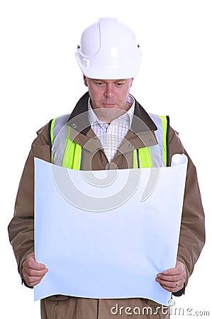 Architect reading plans.