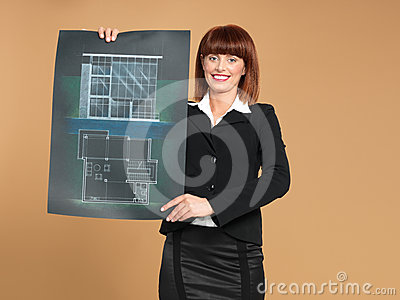 Architect showing blueprint of house
