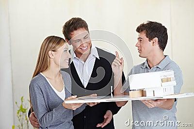 Architect showing house model