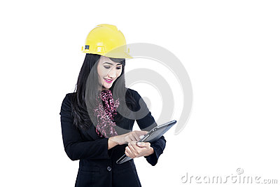 Architect touching tablet isolated in white
