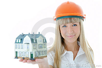 Architect woman with little house on hand