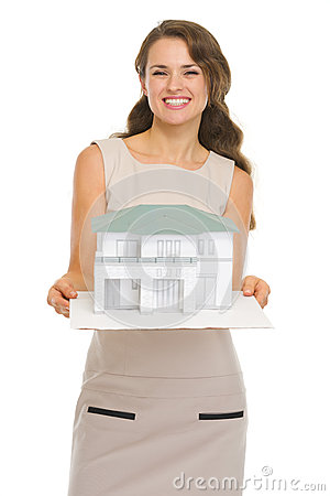 Architect woman showing scale model of house