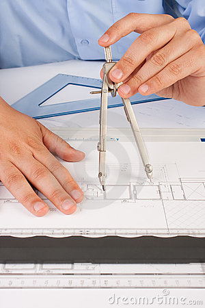 Architect working on architectural plans