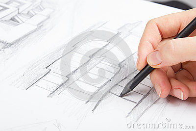 Architect working on blueprint architects stock photo for Blueprint estimator