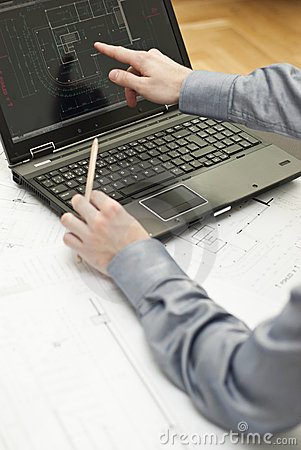 Architect working on notebook