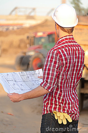 Architect working outdoors on a construction site