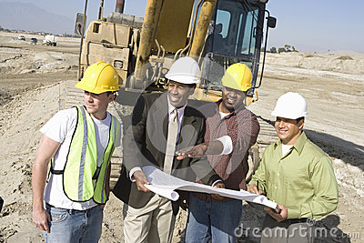 Architects Discussing At Construction Site