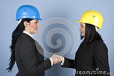 Architects women shaking hands