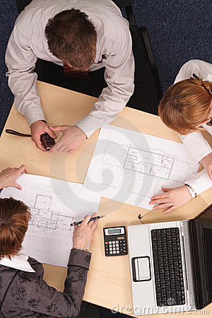 Architects working with blueprints
